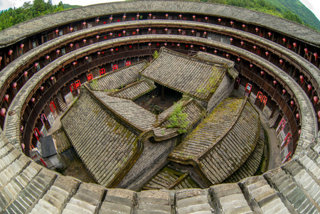 Photo for Aerial view of fujian tulou (hakka roundhouse). There are couplets with lucky poem on every door. - Royalty Free Image
