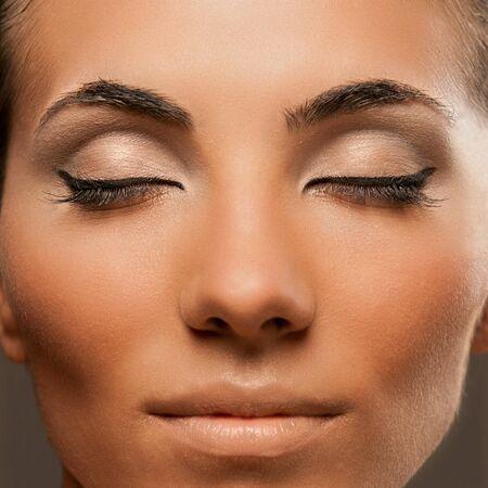 Closeup shot of beautiful female model with professional fashion makeup