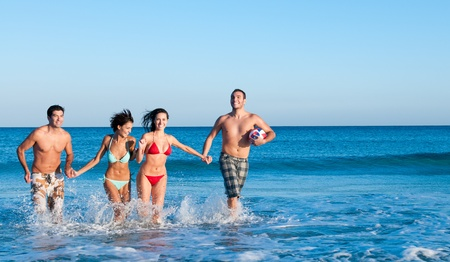 Photo for Happy smiling group of friends playing together at beach - Royalty Free Image