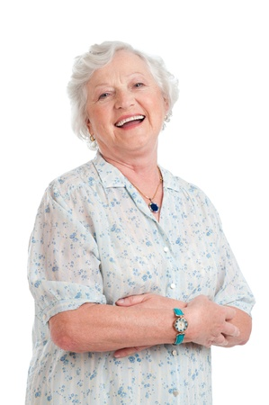 Happy joyful senior lady looking at camera and smiling isolated on white background