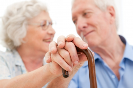 Serene aged husband and wife supporting and staying together during the old age