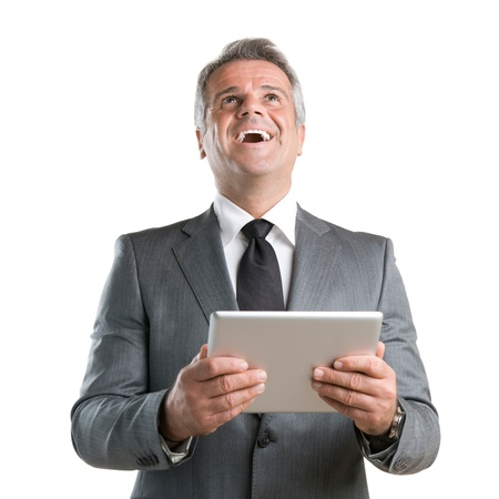 Happy joyful businessman cheering while working with his digital tablet isolated on white background