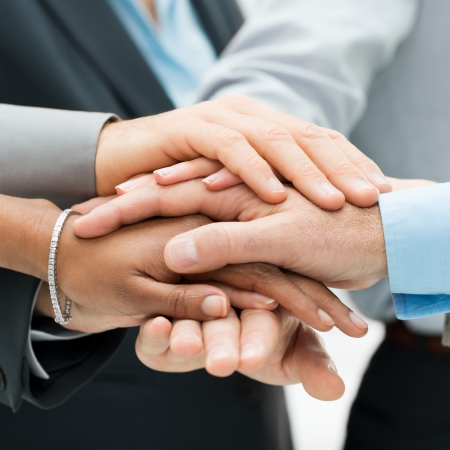 Photo for Closeup Of A Business Colleagues With Their Hands Stacked  - Royalty Free Image