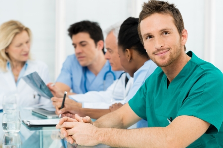 Photo for Portrait Of Young Happy Surgeon With His Team - Royalty Free Image