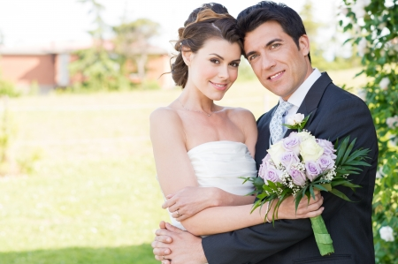 Foto de Portrait Of Happy Beautiful Young Married Couple - Imagen libre de derechos