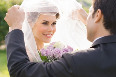Foto per Closeup Of Groom Looking At Bride During the Wedding Ceremony - Immagine Royalty Free