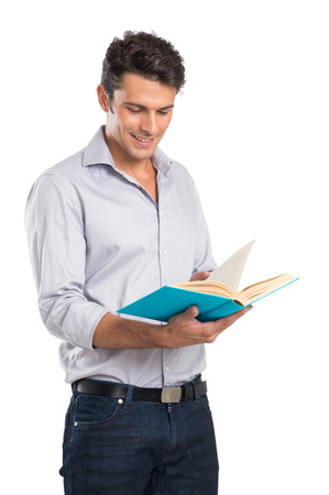 Photo pour Portrait Of A Happy Young Man Reading A Book Isolated On White Background - image libre de droit