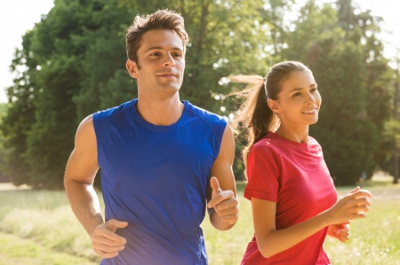 Photo pour Healthy Young Couple Jogging In Bright Sunny Day - image libre de droit