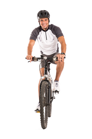 Foto de Portrait Of Young Male Cyclist On Bicycle Isolated Over White Background - Imagen libre de derechos