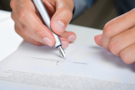 Photo for Close Up Of A Businessman Signing Contract - Royalty Free Image
