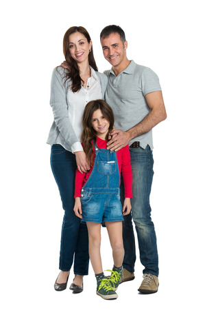 Foto de Portrait Of A Happy Family Looking At Camera Isolated On White  - Imagen libre de derechos