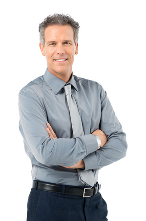 Foto de Portrait Of Proud Mature Businessman Looking At Camera Isolated On White Background - Imagen libre de derechos