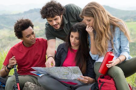 Foto de Group Of Multiracial People Worried Looking The Map - Imagen libre de derechos