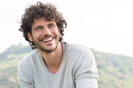 Foto de Portrait Of Young Handsome Man Smiling Outdoor - Imagen libre de derechos