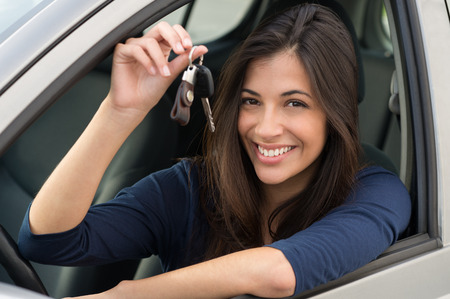 Photo pour Young Happy Woman Showing The Key Of New Car - image libre de droit
