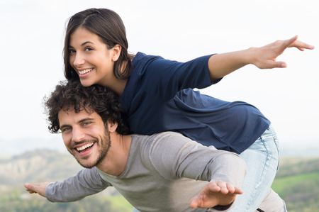 Photo for Portrait Of Young Man Piggybacking His Girlfriend Outdoor - Royalty Free Image