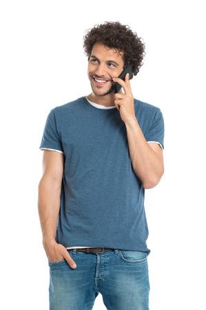 Foto de Portrait Of Happy Young Man Talking On Cellphone Isolated On White Background - Imagen libre de derechos