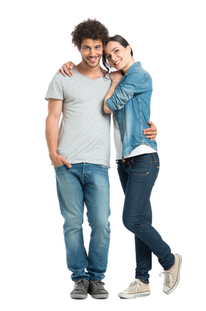 Portrait Of Happy Young Loving Couple Looking At Camera Isolated On White Background