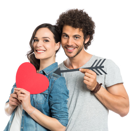 Photo pour Happy Couple Holding Arrow And Paper Heart Isolated White Background - image libre de droit