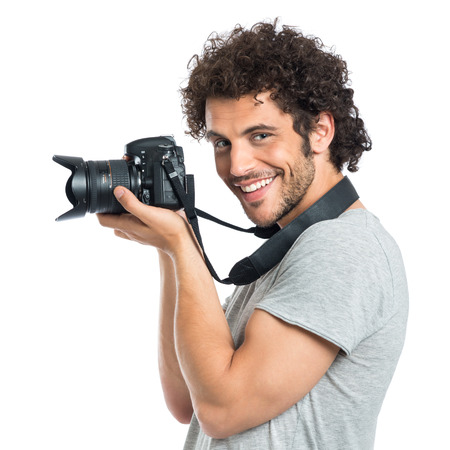 Photo for Young Happy Photographer Holding Camera Isolated On White Background - Royalty Free Image