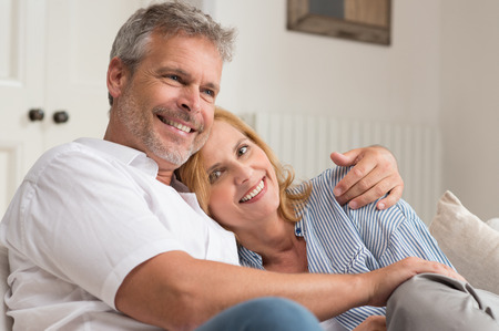 Portrait Of Happy Mature Couple Hugging