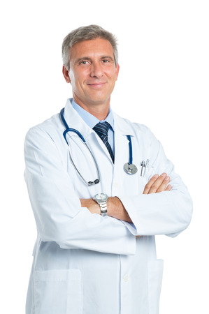 Foto de Portrait Of A Confident Mature Doctor Looking At Camera Isolated On White Background - Imagen libre de derechos