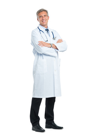 Foto de Portrait Of Smiling Mature Doctor With Arm Crossed - Imagen libre de derechos