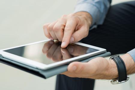 Foto de Closeup Of A Businessman's Hand Using Digital Tablet For Checking e-mail - Imagen libre de derechos