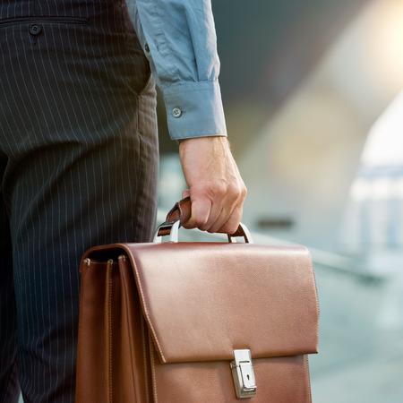 Foto de Closeup Of A Businessman Holding Briefcase Going To Work - Imagen libre de derechos
