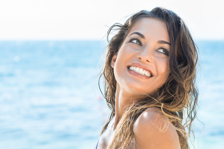 Foto de Portrait Of Young Beautiful Woman Laughing At Summer Beach - Imagen libre de derechos
