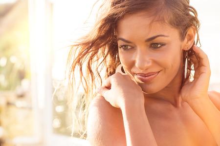 Foto de Portrait Of Smiling Beautiful Girl Relaxing On Vacation - Imagen libre de derechos