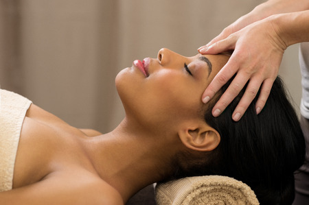Photo for Closeup of young woman receiving professional head massage at spa - Royalty Free Image
