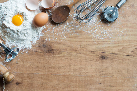Photo pour Fresh ingredients and cooking utensils on rustic table - image libre de droit