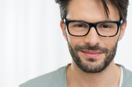 Photo pour Closeup of smiling man wearing eyeglass - image libre de droit