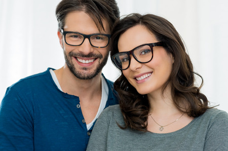 Photo pour Closeup of smiling couple wearing spectacle - image libre de droit