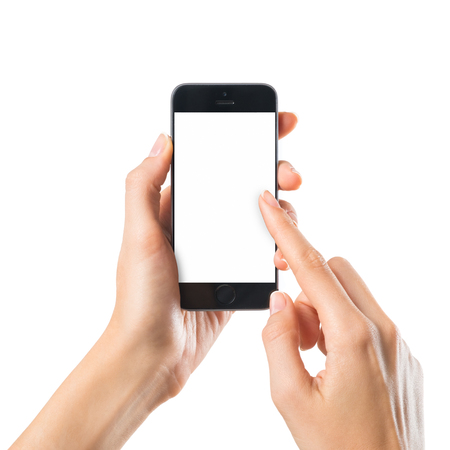 Photo pour Closeup shot of a woman typing on mobile phone isolated on white background.. Girl's hand holding a modern smartphone and pointing with figer. Blank screen to put it on your own webpage or message. - image libre de droit