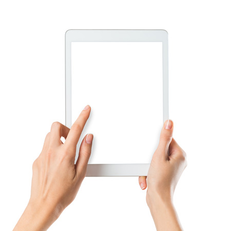 Photo pour Closeup shot of a woman typing a text on digital tablet isolated on white screen. Girl holding a palmtop with white display. Female hands holding a modern digitaltablet with with screen. - image libre de droit