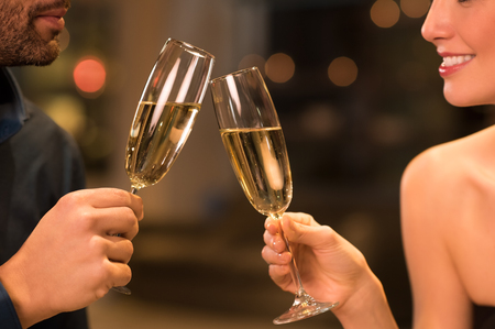Photo pour Couple toasting champagne glasses in a luxury restaurant. - image libre de droit