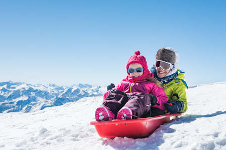 Photo for Happy little brother and cute sister enjoying sleigh ride. - Royalty Free Image