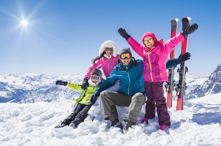 Photo pour Laughing family in winter vacation with ski sport on snowy mountains. - image libre de droit