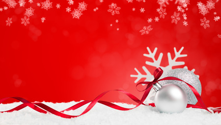 Foto de Christmas background in red. Snow flakes and christmas balls with ribbon and copyspace. Xmas background with snowflakes, balls and ribbon. Write it on whatever you need. - Imagen libre de derechos