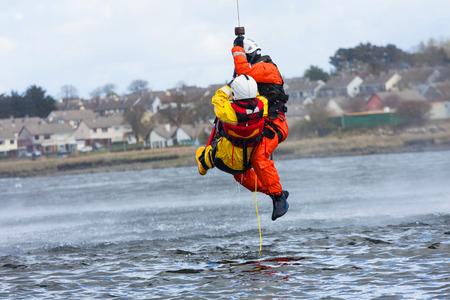 Foto de Irish Coast Guard crew display a water rescue training in the sea - Imagen libre de derechos