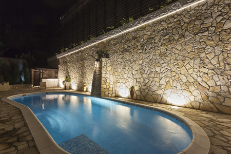 Photo pour Private swimming pool at night - image libre de droit