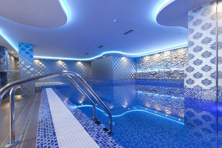 Photo pour Indoors pool with colorful lights at spa center - image libre de droit