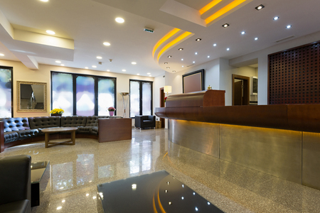 Foto de Reception area with reception desk in modern hotel - Imagen libre de derechos