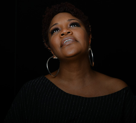 Photo for Very Nice Portrait of a Gospel Singer on Black - Royalty Free Image