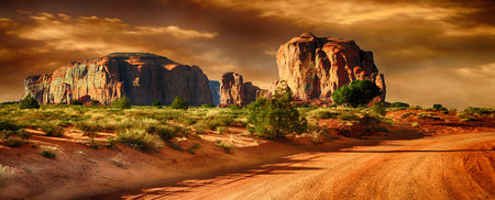 Photo pour Beautiful panoramic Image of a Road through monument Valley - image libre de droit