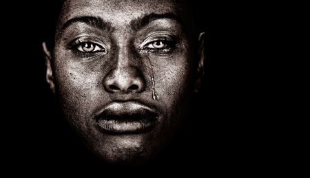 Foto de Very strong Image Of a afro American woman Crying  isolated on Black - Imagen libre de derechos