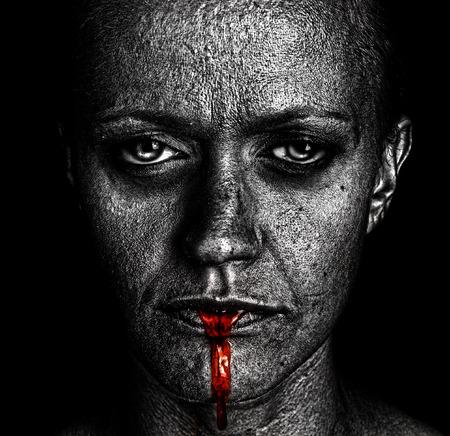 Foto de Disturbing Image of a very depressed Woman on Black - Imagen libre de derechos
