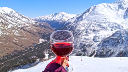 Photo for Close up of glass with red wine over landscape of caucasus mouintains in sunny day, Elbrus - Royalty Free Image
